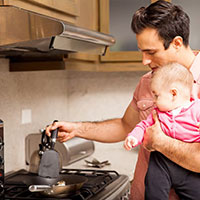 Holding baby in the kitchen